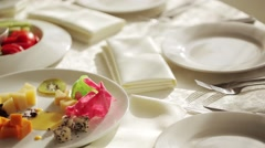A soft toned image of a table setting with plate, napkin Stock Footage
