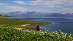 Snow mountains and Sayram Lake Stock Footage