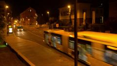 Aerial - Buses driving on city streets at night Stock Footage