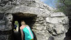 Walking through tunnel entrance into Tulum Ruins in Mexico Stock Footage