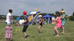 Young teacher perform dance element for children outdoor. 4K Stock Footage