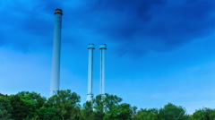 Factory chimney  under blue sky - timelapse Stock Footage