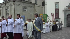 Priests and monks carry flags and chant in religious procession. 4K Stock Footage