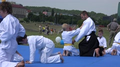 Aikido art trainer learn children martial art in open air . 4K Stock Footage