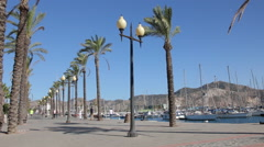 Tourists walking along the promenade of Cartagena, Spain Stock Footage
