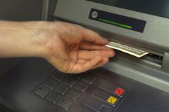 Stock Photo of Person receiving money from the ATM.