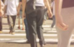 Stock Photo of High blurred image of workers going back home after work. Unrecognizable face