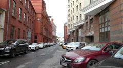 Street with old cars and the high walls of buildings Yakimanka September 2015 Stock Footage