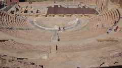 Tourists walking in the Amphitheater Romano in Cartagena, Spain Stock Footage