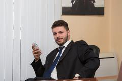 Businessman Talking On Telephone In Office Stock Photos
