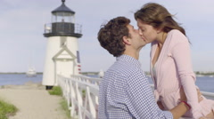 Cute Couple Flirt And Kiss In Front Of Lighthouse In New England Stock Footage
