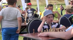 Child play chess in school  game contest outdoor. 4K Stock Footage