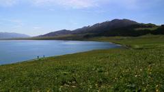 Snow mountains and Sayram Lake Stock Footage