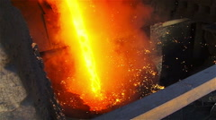Stream of fire in a vat and flying sparks - stock footage