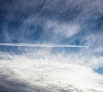 Contrail and cloudscape - stock photo