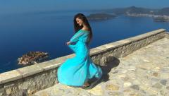 Beautiful brunette smiling Girl with Healthy Long Hair in blowing dress Outdoors Stock Footage