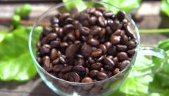 Coffee beans fall into the cup. Stock Footage