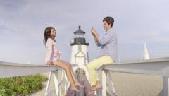 Young Man Takes Photos Of His Beautiful Girlfriend At A New England Lighthouse Stock Footage