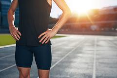 Runner on athletics running track - stock photo