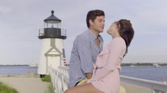 Beautiful Couple Kiss In Front Of New England Lighthouse Stock Footage