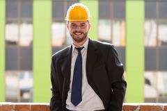 Young Construction Worker In Hard Hat - stock photo