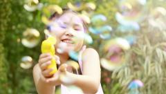 Little Girl Playing with Soap Bubbles, Outdoor Having Fun Stock Footage