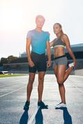 Fit athletes on race track Stock Photos