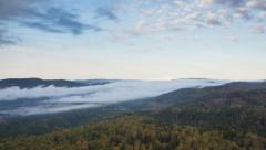 Fog spreads across the river valley Stock Footage