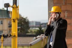 Businessman Talking On Phone And Smoking A Cigar Stock Photos