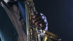 Old african black colored man playing saxophone closeup Stock Footage