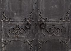 Wrought iron doors. with handle Stock Photos