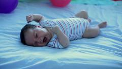 Restless infant lying on back. Stock Footage