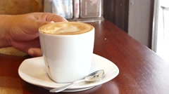 Relexing in coffee break time wiht hot cappuccino Stock Footage