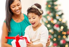 Stock Photo of happy mother and child girl with gift box