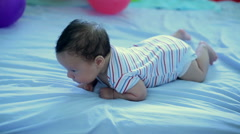 Infant lies on his stomach Stock Footage