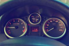 Backlit gauges of an automobile. - stock photo