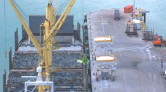 Unload fertilizer from a ship in time lapse Stock Footage