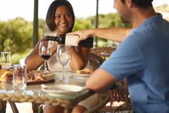 Couple enjoying red wine at winery restaurant Stock Photos
