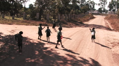 Kids Playing Stick Ball in the Street in Kitwe, Zambia Stock Footage