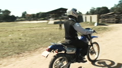 Morning Dirt Bike Commute in Kitwe, Zambia Stock Footage