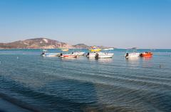 Boats at the Laganas beach in afternoon sun - stock photo