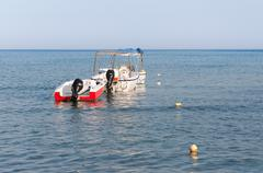 Motorboats at the Laganas beach in afternoon sun - stock photo