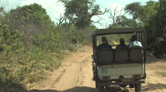 A Safari Truck Rides down the Road of the South Luangwa National Park Stock Footage
