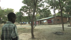Young Orphan Walks His Village in Kitwe, Zambia Stock Footage
