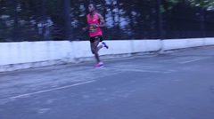 Black lead runner in the marathon Stock Footage