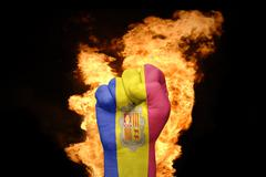 Stock Photo of fire fist with the national flag of andorra