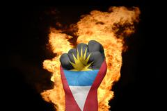 Fire fist with the national flag of antigua and barbuda Stock Photos