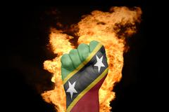 Fire fist with the national flag of saint kitts and nevis Stock Photos