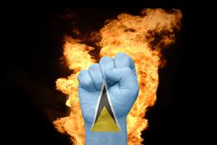 Fire fist with the national flag of saint lucia Stock Photos
