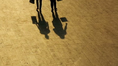 Silhouettes of people walking in the streets of the city Stock Footage